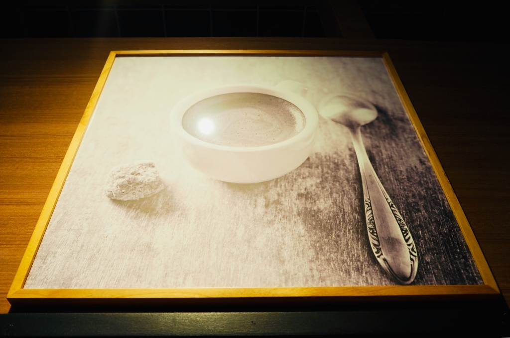 key's cafe interior art on display. portrait of a cup of coffee and spoon